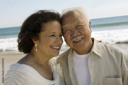 Senior Newly wed couple at beach, close-up