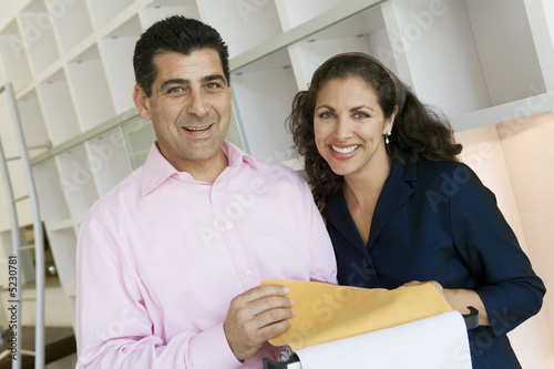 Couple Examining Fabric Swatches in furniture store, portrait