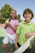 Brother and Sister at Tennis Net, portrait