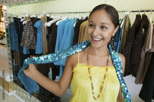 Girl Trying on Sequin Boa