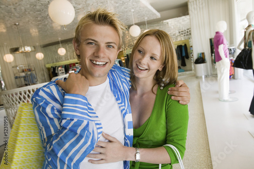 Young Couple Shopping in clothing store Together, portrait
