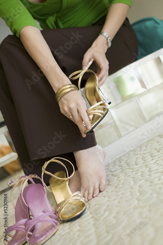 Woman Trying on Shoes in clothing store, low section, ground view
