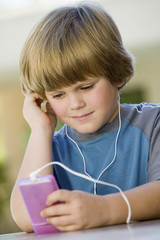 Boy Listening to Music on MP3 Player