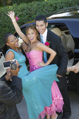 Teenagers Videotaping Their Prom