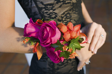 Teenage girl wearing corsage, close-up of flowers