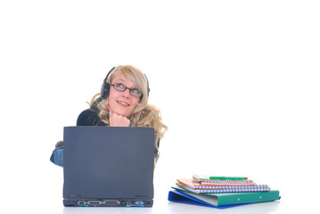 Teen listening music on laptop