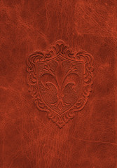 Vintage leather texture with the fleur-de-lis symbol