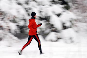 running in winter forest