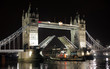 Night shot of Tower Bridge, paddle steamer passing by
