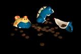 broken bank spilling pennies poster