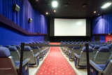empty cinema auditorium with black cordon poster