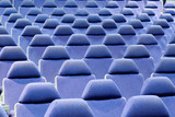 blue chairs in an empty cinema auditorium poster
