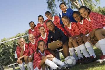 Coach with girls' soccer team 13-17