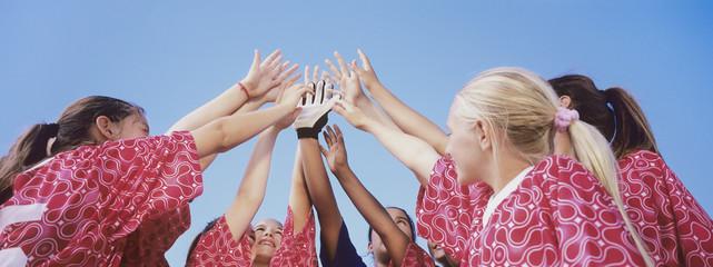 Soccer Team Giving High Five