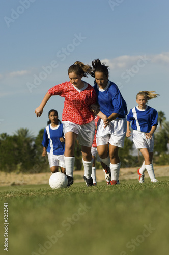 Teenage Girls Playing Soccer