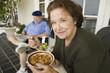 Senior couple having breakfast on porch