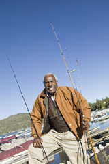 Middle-aged fisherman standing at marina, portrait