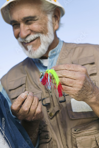 Middle-aged fisherman outdoors