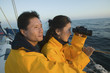 Couple with Binoculars on Boat