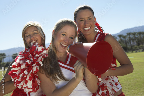 Cheerleaders Holding Megaphone on field, portrait, portrait