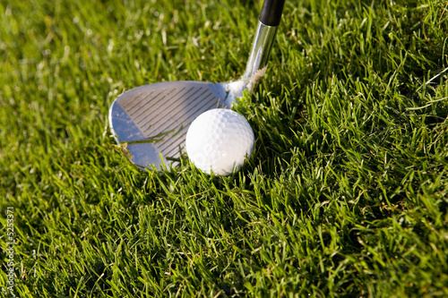 Golfer teeing off, close up on ball