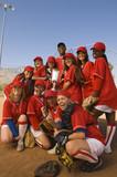 Women's softball team with trophy, portrait
