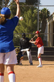 Pitcher throwing softball to batter