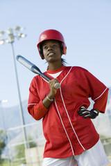 Young woman holding softball bat, portrait
