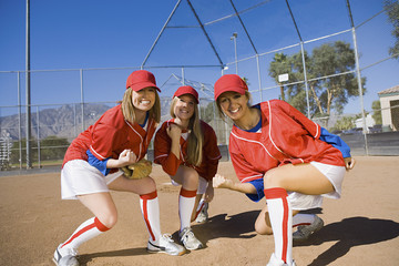 Young female softball players, portrait