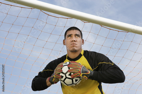 Goalkeeper holding ball, portrait