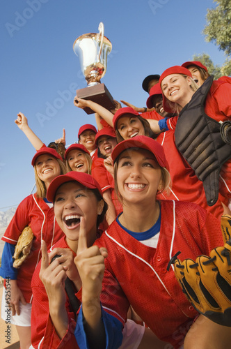 Women's softball team with trophy, portrait, low angle view