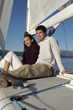 Young couple sitting on sailboat