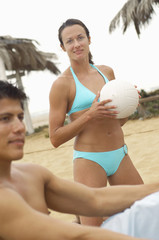 Woman in Bikini Holding Volleyball, portrait