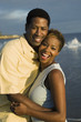Couple embracing at ocean, portrait