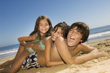 Children in swimwear playing on beach