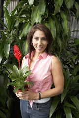 Woman with potted tropical plant, portrait