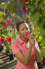 Woman smelling flower at nursery