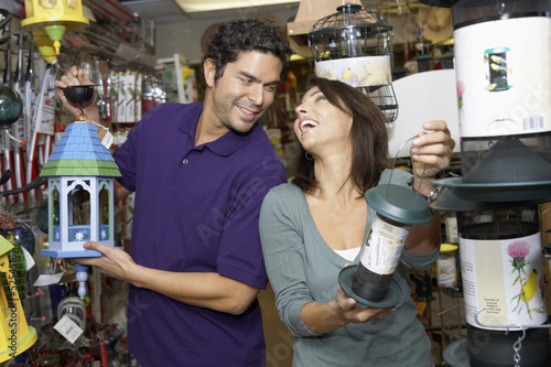 Couple choosing lanterns in shop