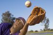 Baseball outfielder catching ball, close-up