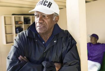 Baseball coach in dugout