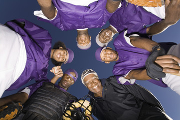 Baseball team in huddle, portrait, view from below