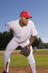 Baseball pitcher preparing to throw during game