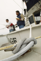 Fishing boat tied to dock