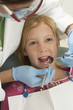 Girl 7-10 having teeth examined at dentists
