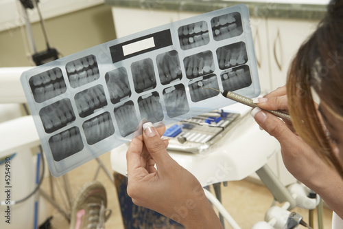 Dentist examining X-rays, close-up
