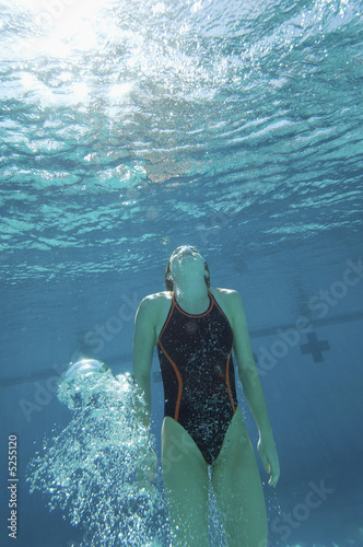 Swimmer coming up for air, underwater