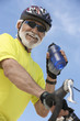 Cyclist drinking from bottle of water, portrait, low angle view