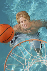Young Man Playing Water Basketball, view from above