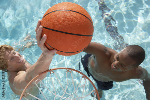 Two Young Men Playing Water Basketball, view from above