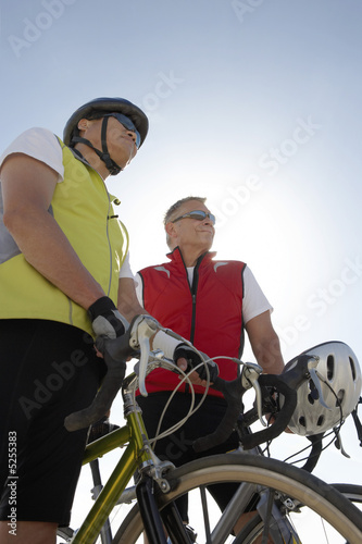 Two men on bicycle ride, portrait, low angle view